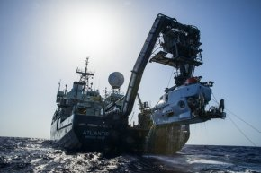 the study vessel Atlantis with all the submersible Alvin dangling down its stern.